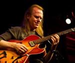 Dave Becker playing guitar